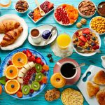65705167 - breakfast buffet healthy continental coffee orange juice fruit salad croissant
