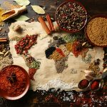 38931441 - map of world made from different kinds of spices on wooden background